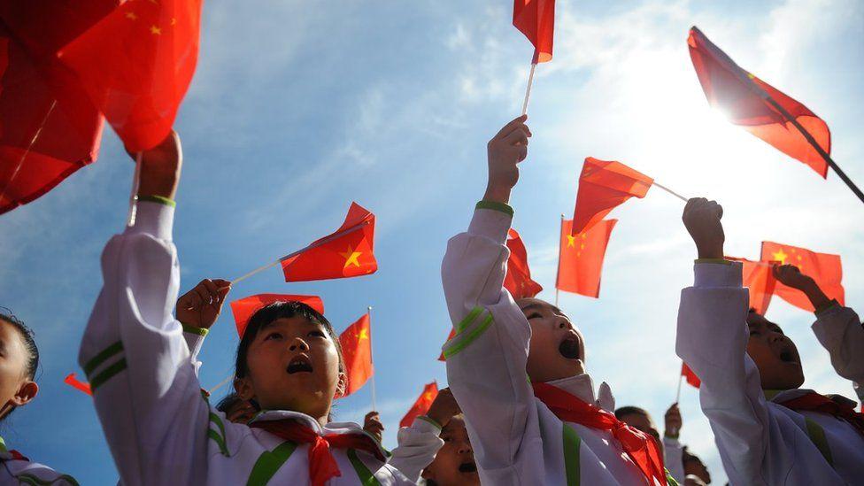 Children waving Chinese flags