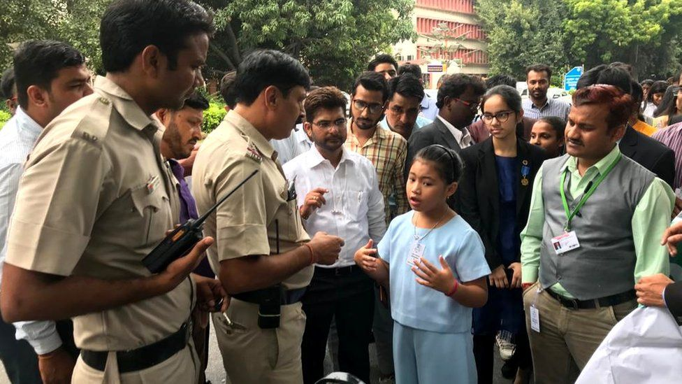 Licypriya Kangujam, eight, speaks with police who are trying to prevent her from demonstrating near India's parliament, 2019