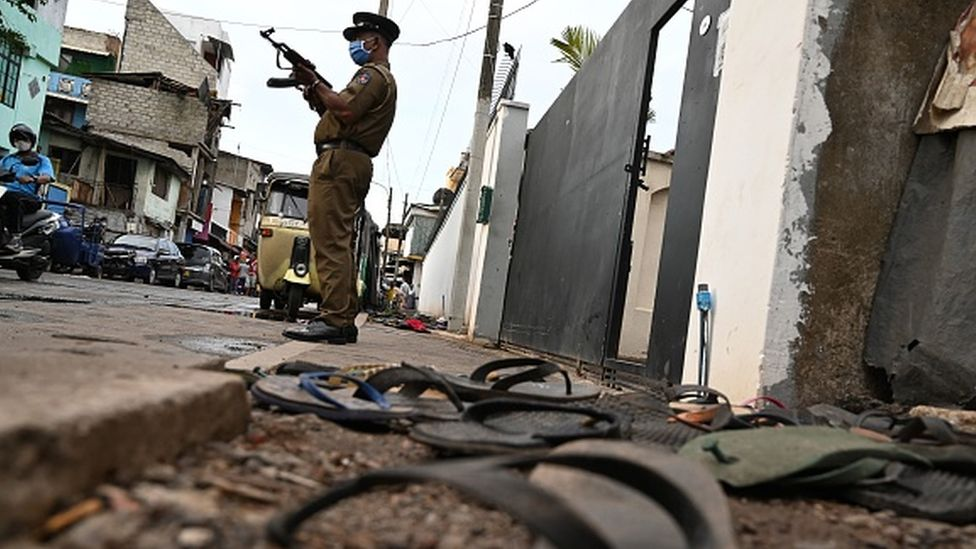 Police outside a warehouse in Colombo