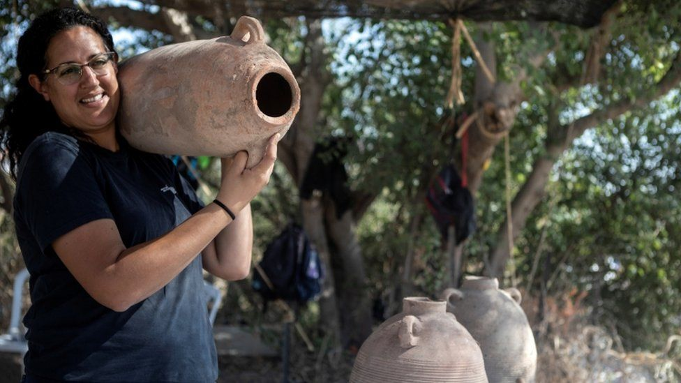 Archaeologist carries Gaza Jar at the site