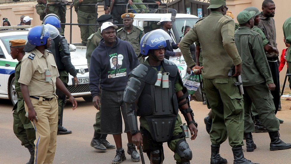 Zambian police break up skirmishes between rival political supporters on August 10, 2016 in Lusaka