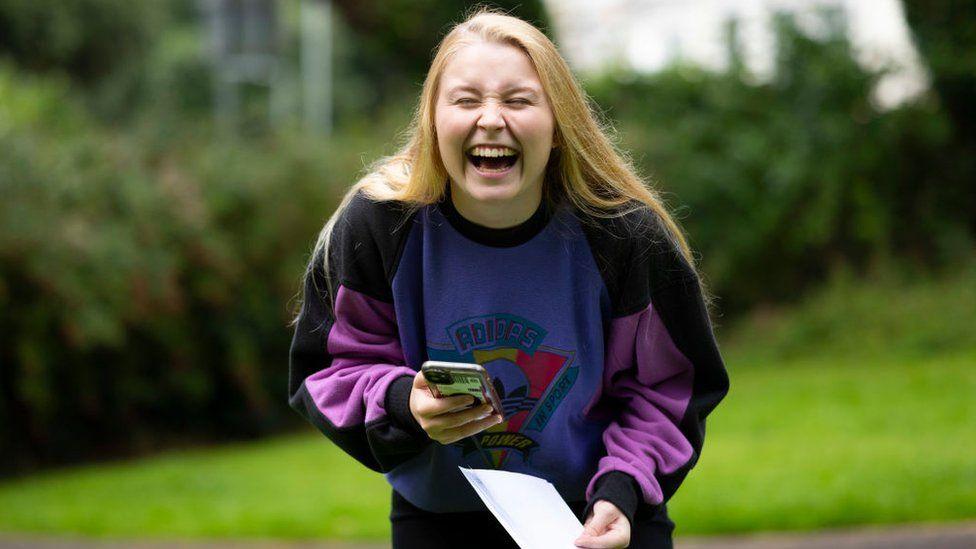 Georgia Davies laughs after opening her A Level results at Ffynone House school
