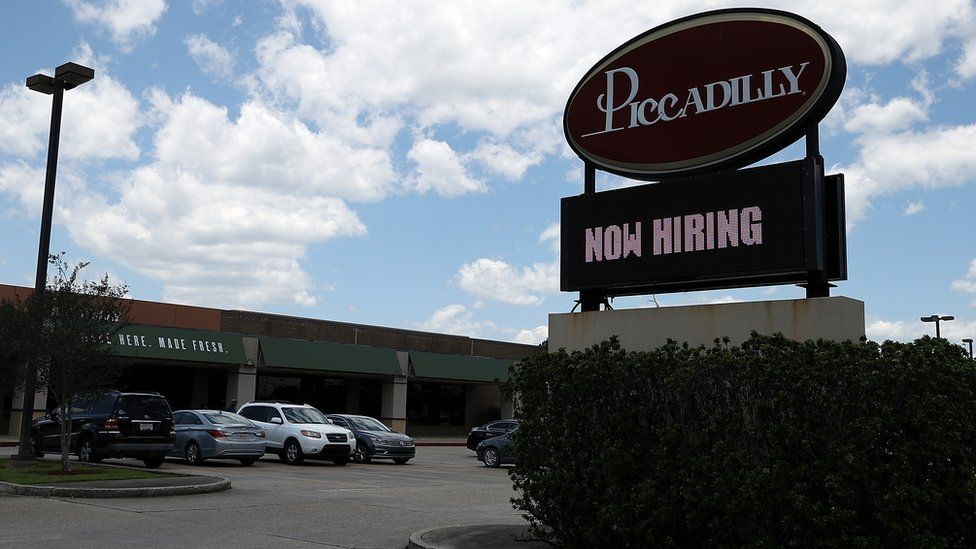 A now hiring sign is posted in front of a Picadilly restaurant on May 5, 2017 in Baton Rouge, Louisiana.
