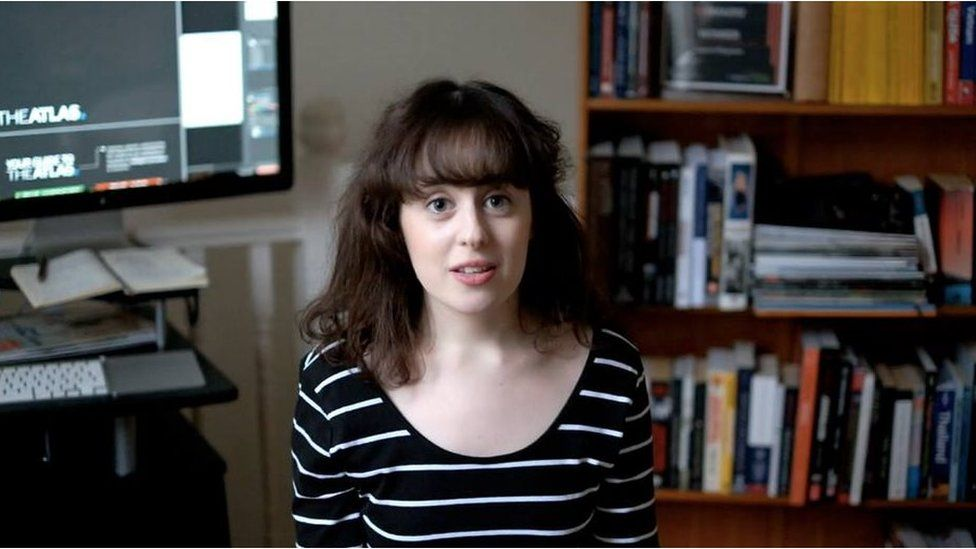 Natasha Lipman sitting near her computer