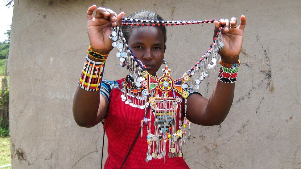 A Maasai woman showcases her beadwork in the community of Amboseli