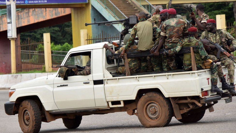 Members of the Armed Forces of Guinea drive through the central neighbourhood of Kaloum in Conakry on September 5, 2021 after sustainable gunfire was heard.
