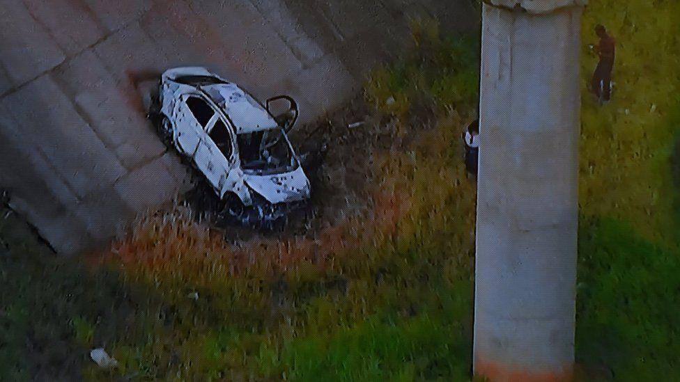 Picture of a TV set taken while TV Globo News shows the car of Greek ambassador in Brazil, Kyriakos Amiridis in Nova Iguacu on December 30, 2016