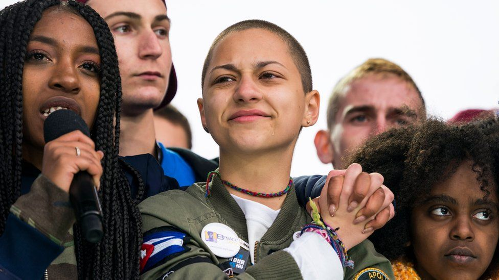 Emma Gonzalez (C), a survivor of the school shooting at Marjory Stoneman Douglas High School, cheers at the conclusion of the March For Our Lives in Washington, DC, USA, 24 March 2018.