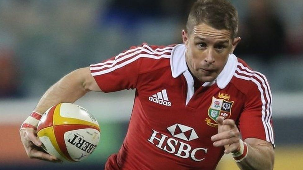 Former rugby international Shane Williams running with a rugby ball while in action for the British Lions