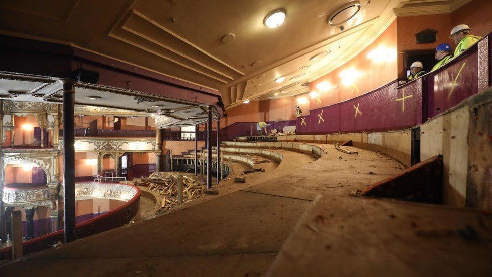Developers surveying the Opera House stalls. The seating and carpets have been removed