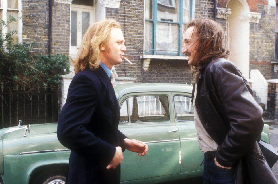 Daniel Craig, left, and Christopher Eccleston in episode four, set in 1970