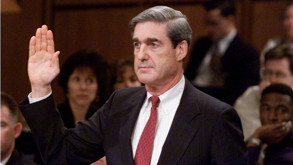 Robert S. Mueller III, President Bush's choice to become director of the Federal Bureau of Investigation, raises his right hand while being confirmed in 2001