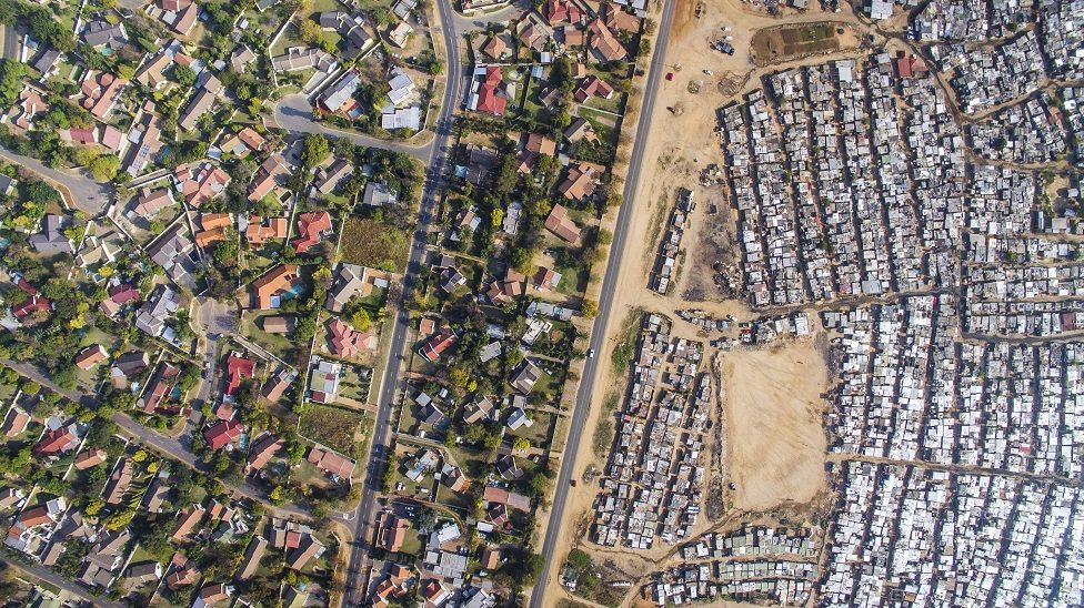 Aerial view of Kya Sands / Bloubosrand, Johannesburg, South Africa, showing a great disparity of wealth.