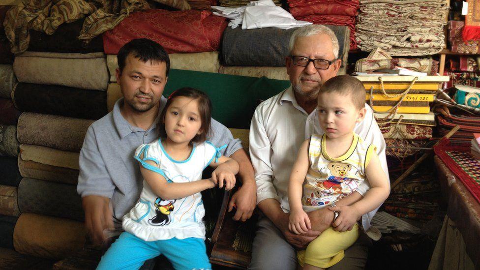 Abdul Aziz with his son and grandchildren