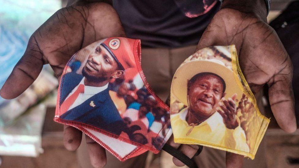 Face masks showing presidential candidates in Uganda - Bobi Wine, left, and Yoweri Museveni, right
