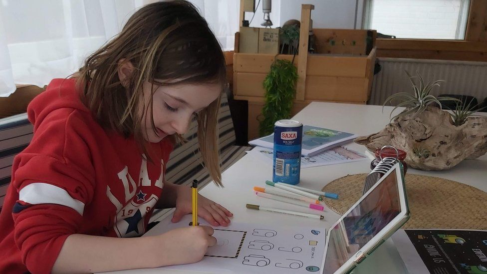 Bella doing a home-education activity