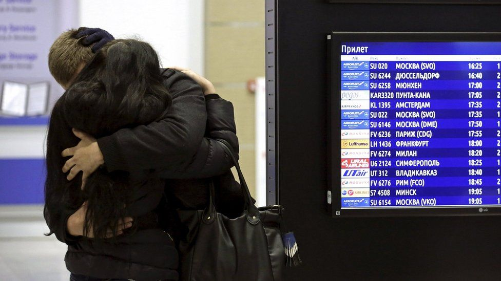 Relatives of passengers hug at Pulkovo airport, St Petersburg - 31 October