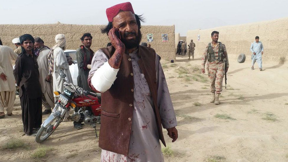 A man who was injured in a suicide bomb attack that targeted an election campaign rally of the Balochistan Awami Party (BAP), talks on a mobile phone, in Mastung, Pakistan, 13 July 2018.