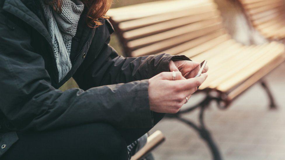 Teenager using phone (generic)