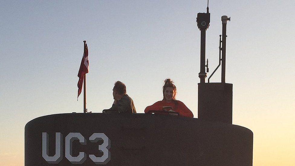 Peter Madsen next to Kim Wall on submarine