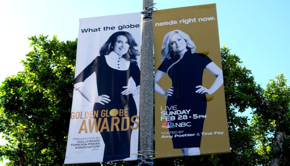 Poster yang menampilkan Tina Fey dan Amy Poehler