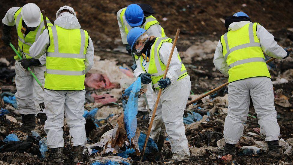 Detectives sifting through rubbish
