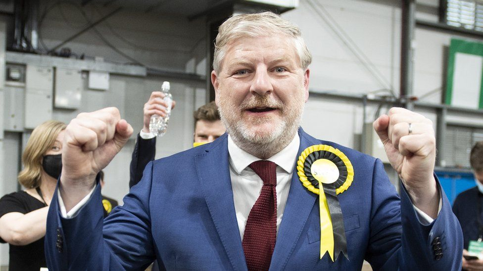 Angus Robertson reacts after winning his seat for at the Parliamentary Elections