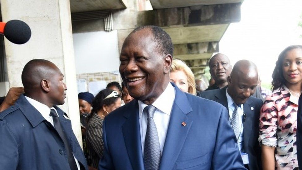 Ivory Coast president Alassane Ouattara leaves a polling station after voting in Abidjan during Ivory Coast presidential elections