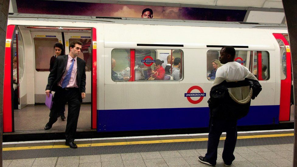 Bakerloo Line train and commuters
