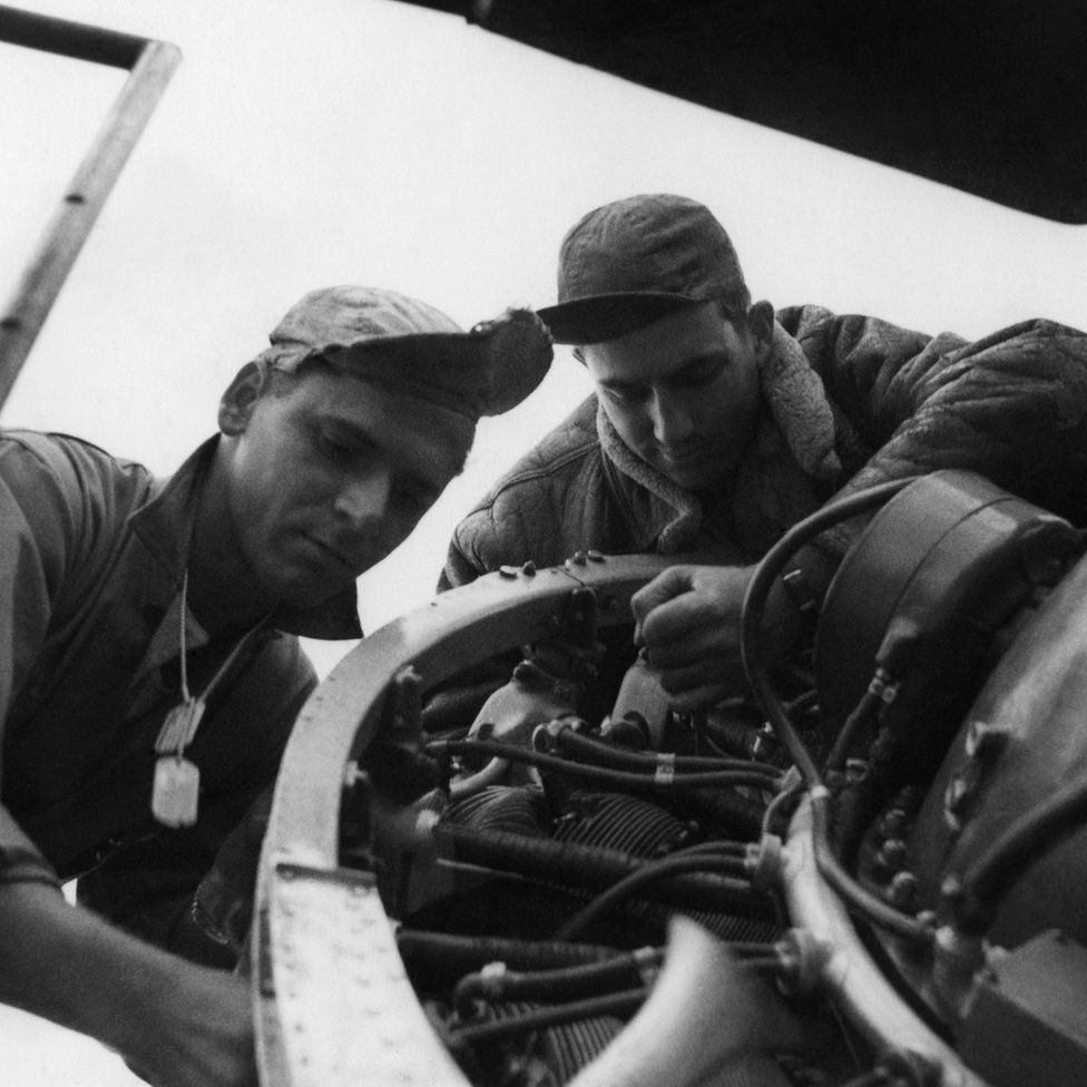 Technical Sergeant Lester Reifeiss (left) and Sergeant Jasper 'J D' Taylor of the 78th Fighter Group repair a P-47 Thunderbolt at Duxford, Cambridgeshire.