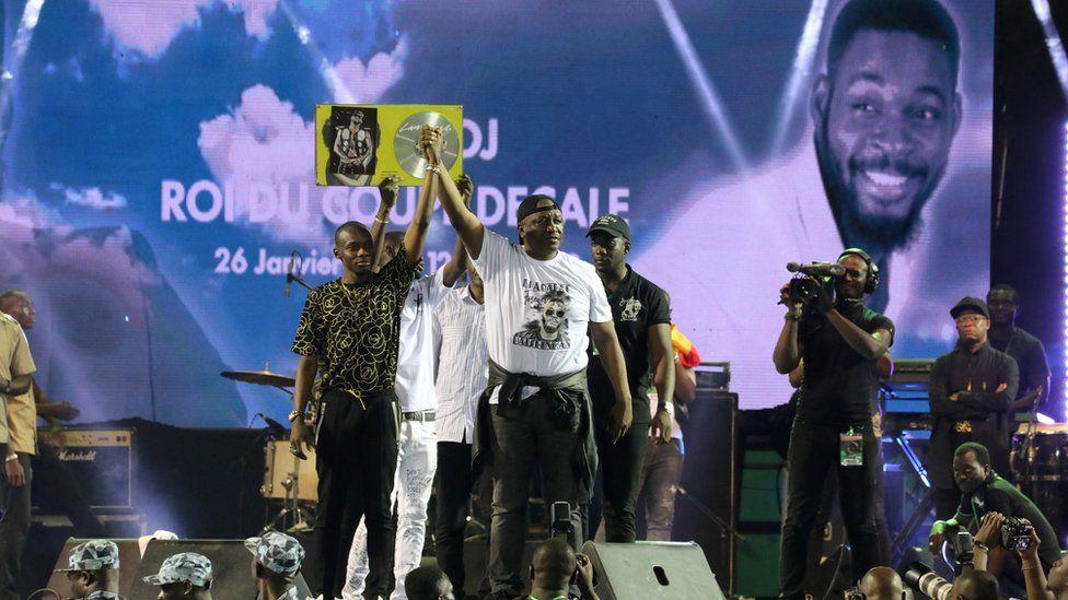 Malian singer Sidiki Diabate and Ivory Coast Defence Minister Hamed Bakayoko on stage