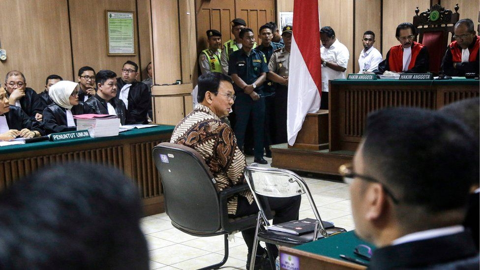 """""""Ahok"""" sits on the defendant's chair in the middle of the court, 13 December 2016, Jakarta, Indonesia."""