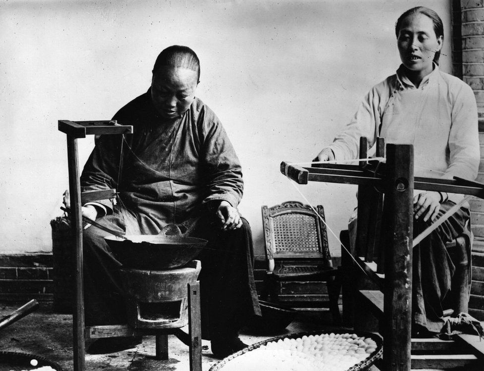 Chinese workers spinning silk, circa 1912