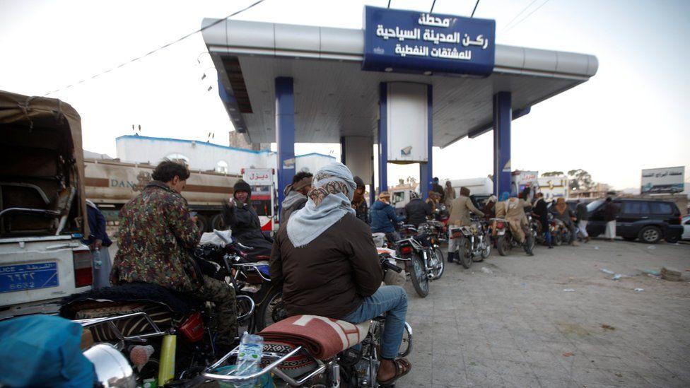 Motorcyclists queue at a petrol station amid fuel shortages in Sanaa, Yemen (10 November 2017)
