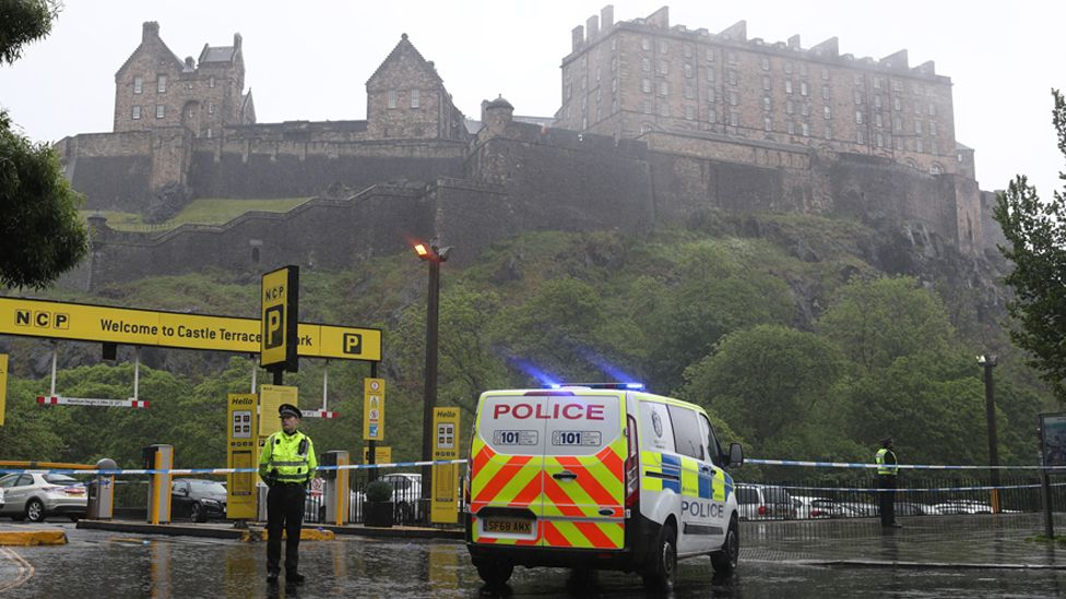 Police with Edinburgh Castle behind