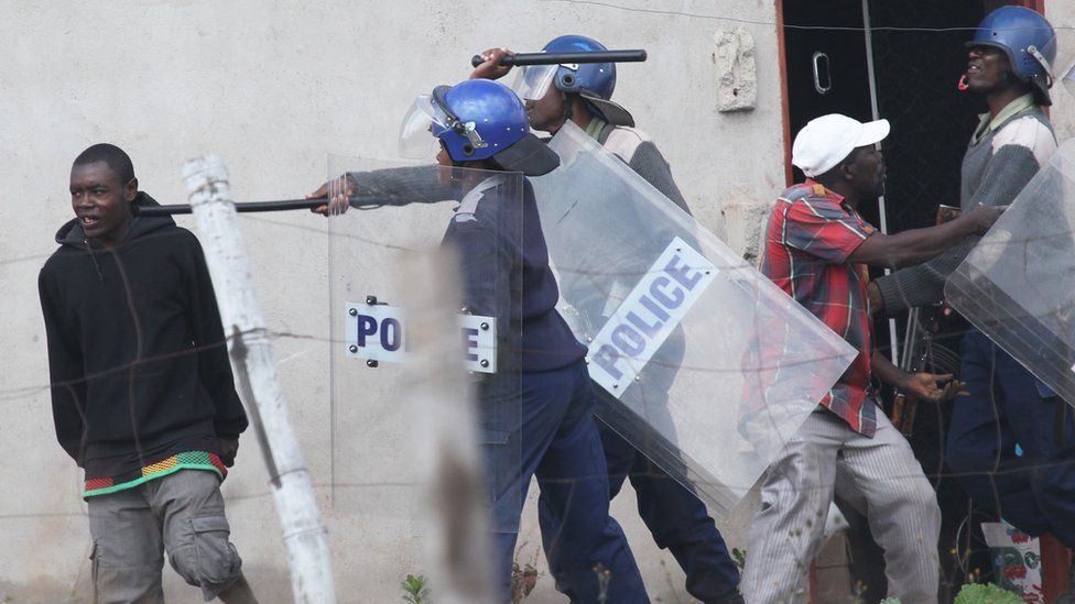 Police clash with rioters in Harare, Zimbabwe - Monday 4 July 2016