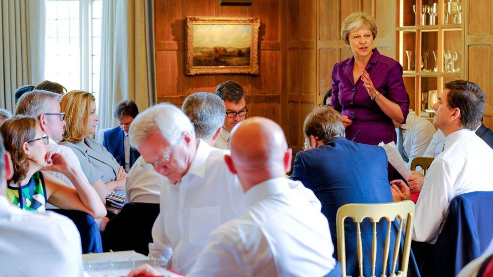 Prime Minister Theresa May speaks during a cabinet meeting at Chequers