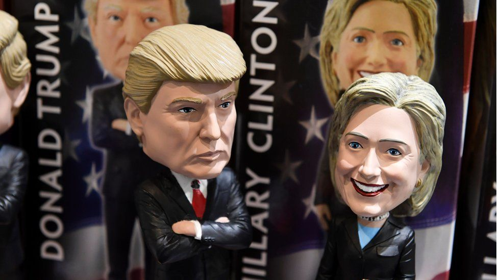Bobblehead dolls of US Republican presidential nominee Donald Trump and Democratic presidential nominee Hillary Clinton are seen for sale in a gift shop at Philadelphia International Airport, October 20, 2016 in Philadelphia, Pennsylvania