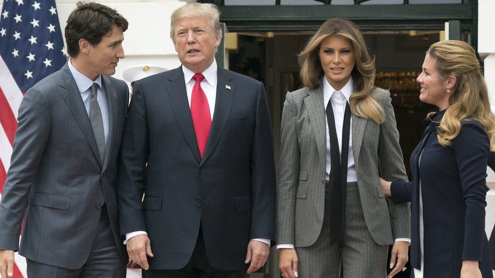 US President Donald Trump (2-L) and First Lady Melania Trump (2-R) welcome Prime Minister of Canada Justin Trudeau (L) and his wife Sophie Gregoire Trudeau (R) to the White House on 11 October 201