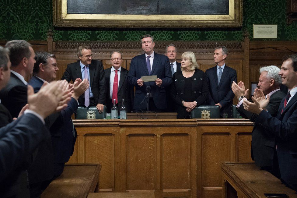 Sir Graham Brady stands with others in the Houses of Parliament