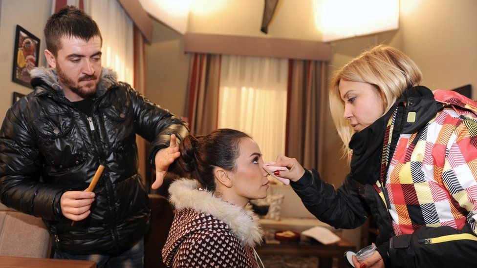 Turkish soap opera actress Songul Oden having make-up applied