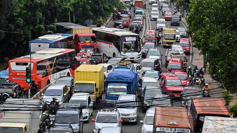Motorists are seen during a traffic jam in Jakarta on March 6, 2019.