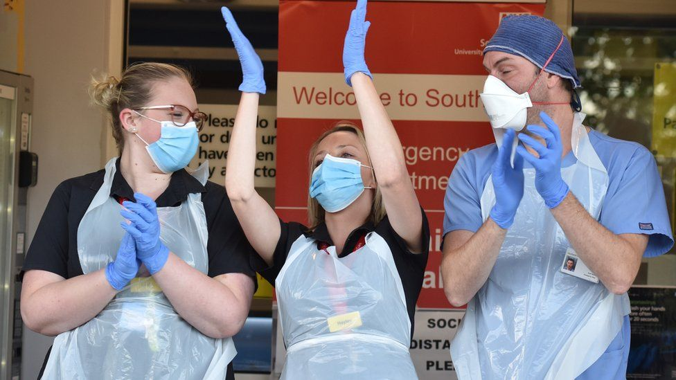 Medical staff attend the clap for carers at the Southend University Hospital on May 28, 2020
