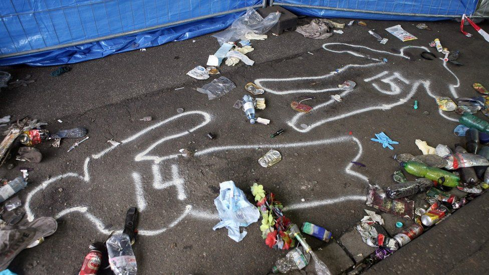 Outlines of bodies drawn on the pavement at the entrance to the tunnel where panic broke out during the Love Parade techno music festival in Duisburg on 25 July 2010