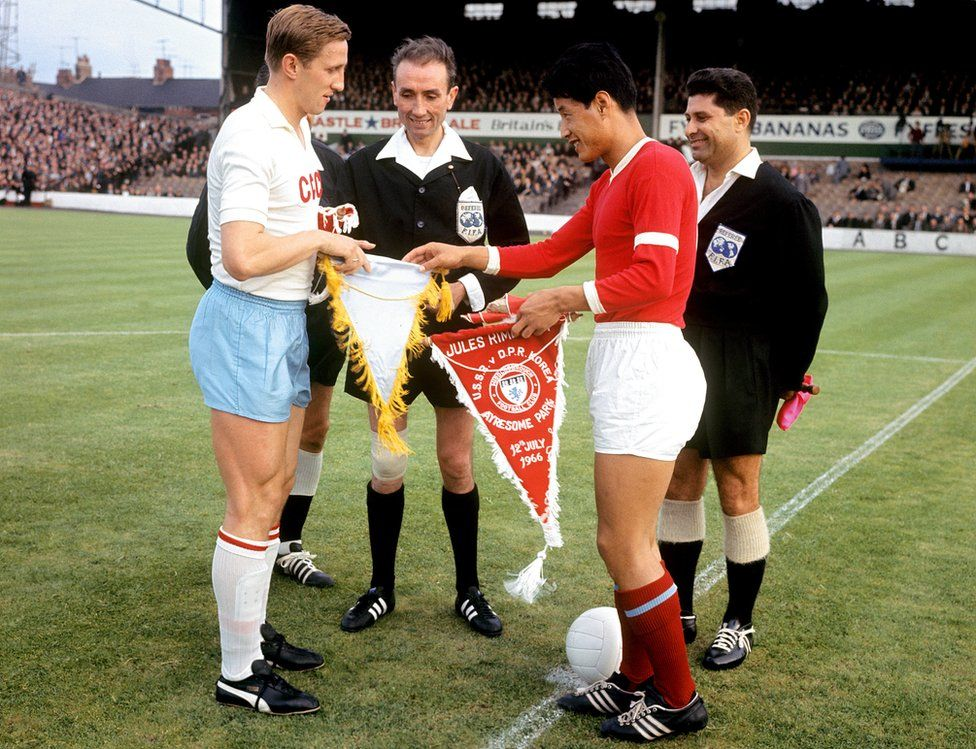 USSR captain Albert Shesterniev (l) shakes hands with North Korea captain Shin Yung Kyoo (r) before the match between the two teams at Ayresome Park