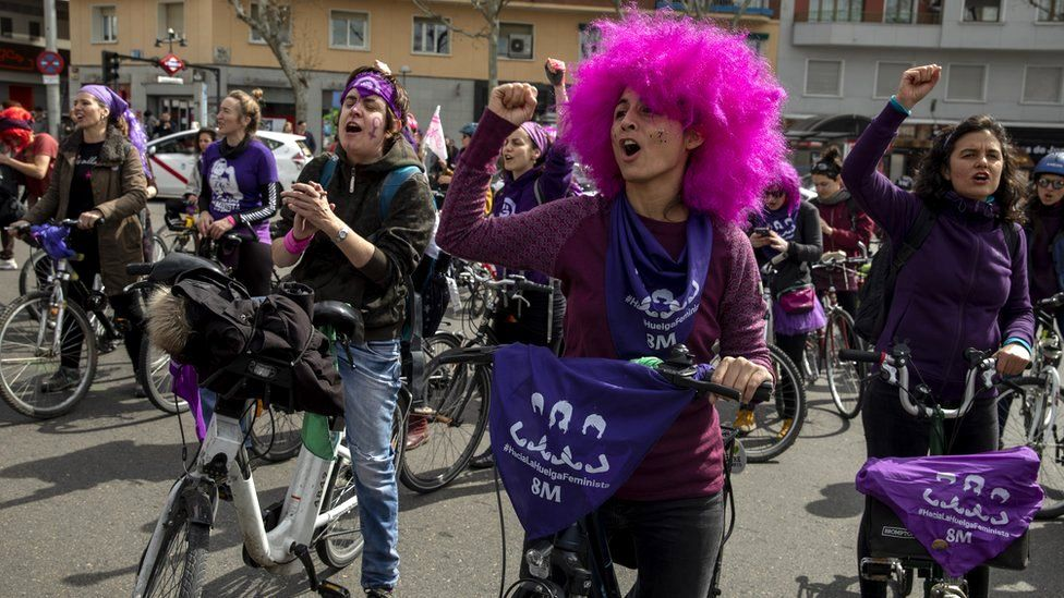 Women wear purple as they take part in a feminist bicycle protest during International Women's Day in Madrid, Spain, 8 March 2020