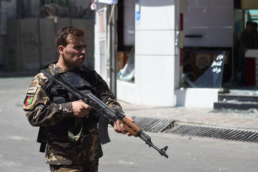 An Afghan security personnel stands guard near the site of a truck bomb attack in Kabul on 31 May 2017