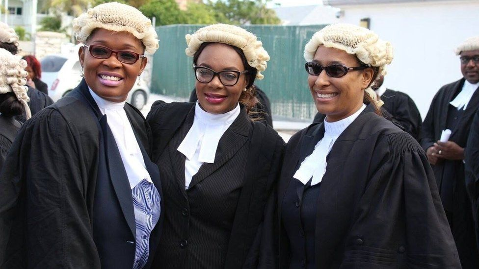Three female lawyers in their robes