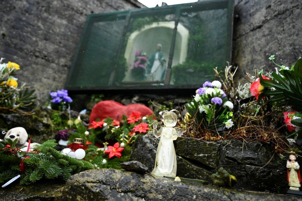 Floral tributes at a graveyard in Tuam where the bodies of 796 babies were found