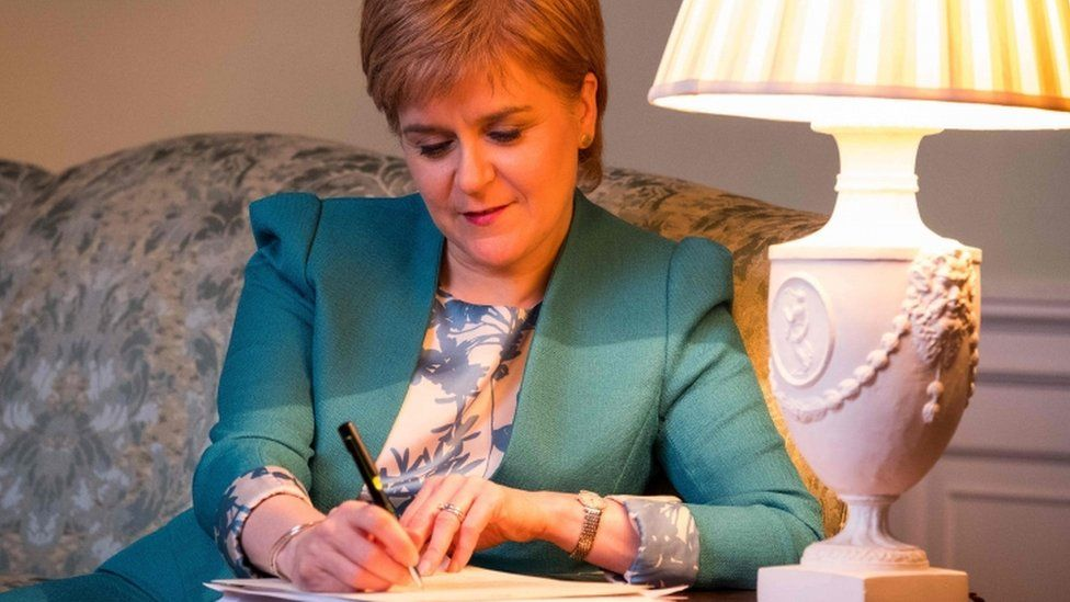 "A handout picture released by The Scottish Government on March 30, 2017 shows Scotland""s First Minister Nicola Sturgeon working on her Section 30 letter to the British Prime Minister Theresa May"